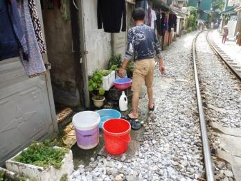 Vietnamese washing the flipflops
